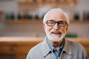 a senior is pleased with his memory care program