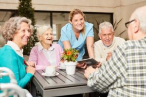 a group is excited about senior living amenities at morada