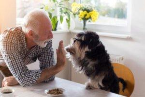 a man celebrates senior living options with his dog