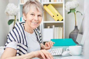 a senior enjoys her senior living options at the victoria east location