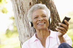 a woman listens to music and takes advantage of independent living for seniors in victoria