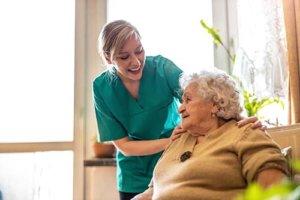 morada cyfair assisted living nurse putting hands on senior woman's shoulders